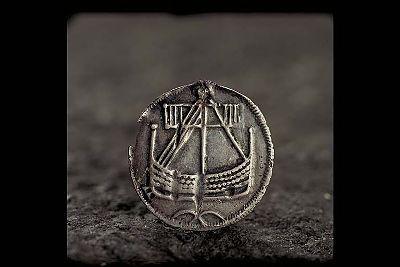 Viking age coin/pendant from Björkö, Adelsö, Uppland, Sweden. From Historiska Museet, Sweden.