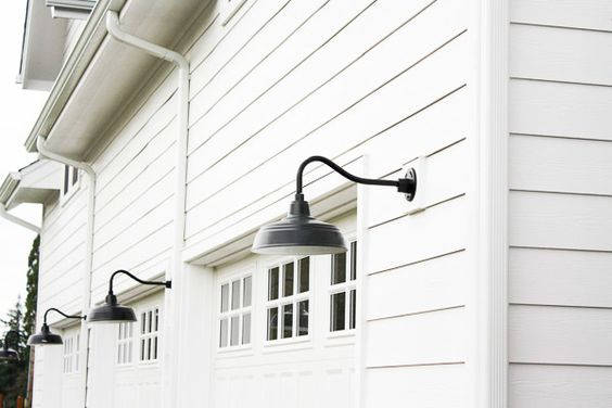 Modern farmhouse lighting and door with window on pinterest for Modern farmhouse garage doors