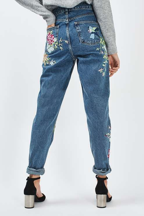 Take florals into the next season in these cool AW16 rigid denim highwaisted mom jeans in mid stone, featuring eye-catching embroideries on the legs and rolled up hems.