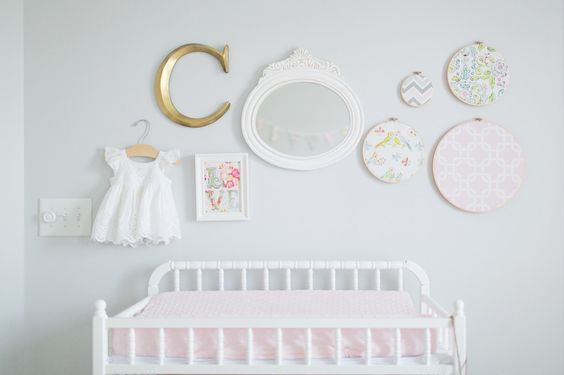Simple, eclectic #gallerywall in #nursery. (You have to see the rest of this shabby chic nursery!)