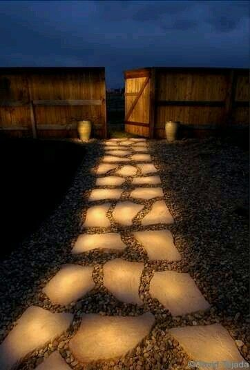 Pathway lit up at night after all day in the sun