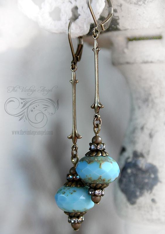 Bohemian and inspired by clear blue skies, these Czech glass and antiqued brass earrings are playful and elegant. Large, sky blue rondelle shaped Czech glass beads are accented with darkened brass bead caps, rhinestone rondelles and hung from elongated, thin connectors. Hung from leverback hooks in aged brass for pierced ears. All components are American-made brass, free of lead and nickel About 2.5