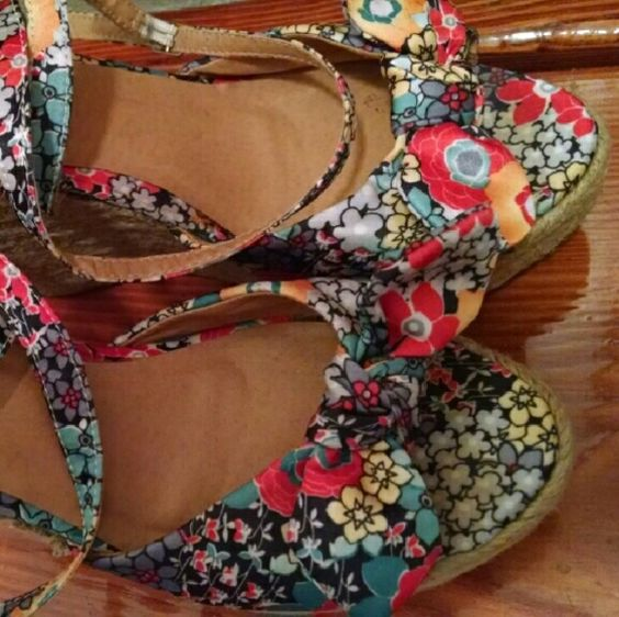 Cute Strappy Wedges Cute floral bow strappy wedges would be cute with dresses, shorts,etc..Gently worn, still in wearable condition. Not brand new!  (See pictures these have been worn a few times. Sold as is! If you are going to buy these and pick them apart with a magnifying glass, please don't bother. )They are not perfect as they have been worn but there are no huge stains, tears, etc.. No hidden damage. Still cute and very nice.   Size 8-9 Rue 21 Rue 21 Shoes Wedges