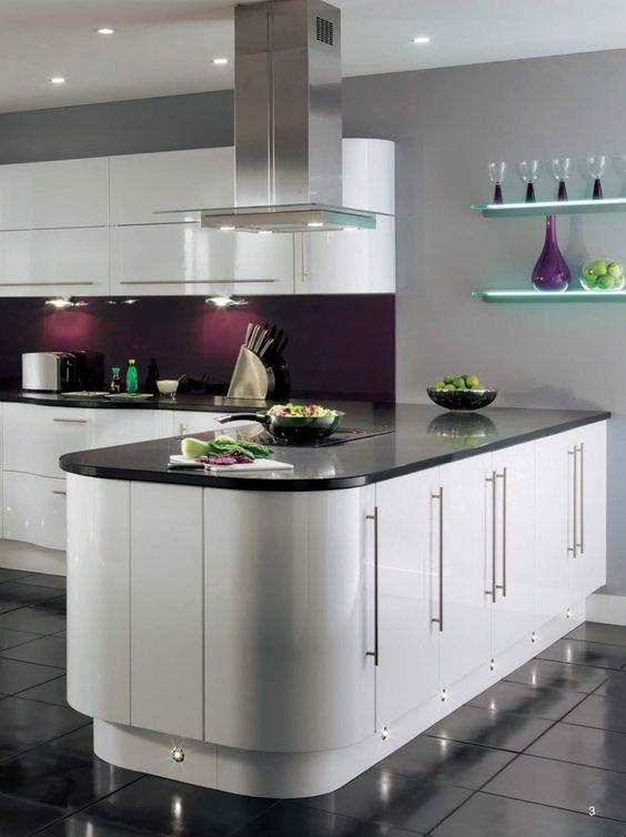 Curved white kitchen units