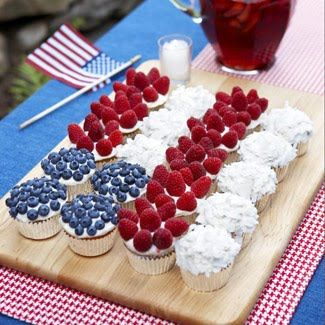 Memorial Day Cupcakes // if you don't have time to bake, buy cupcakes with white frosting and add fruit topping via Good Housekeeping #USA #patriotic