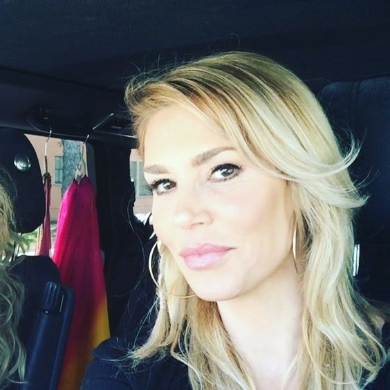 Brandi Glanville taking a selfie in her car