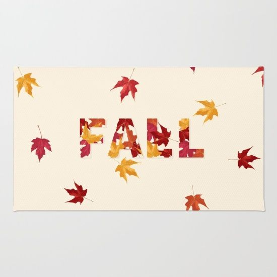 Autumn / Fall themed rug with colourful leaves in red, orange and yellow. September & October. Seasonal home decor.