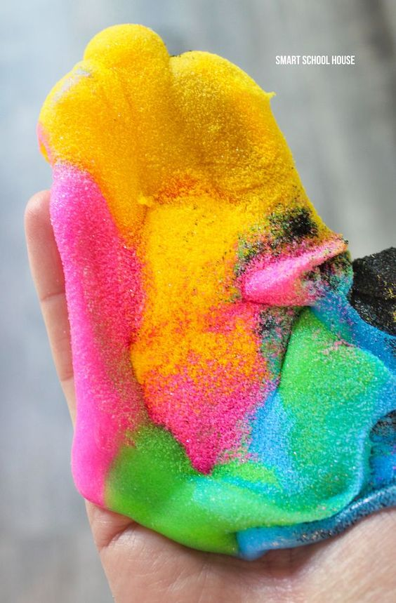 Sand Slime - how to make insanely colorful sand slime with only 3 ingredients (and NO food coloring)! It's stretchy but not sticky making it the perfect DIY craft for kids! Sponsored.