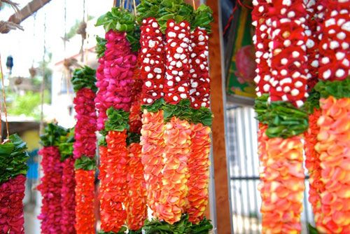 flower-garlands in mumbai india, made by stringing petals together.