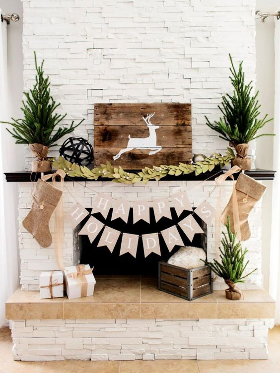 Mantel Decorated With Wooden Plank Art And Pine Leaves