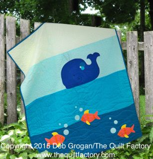 Splash! Fun modern baby quilt with adorable appliquéd whale and fish. Easy to follow instructions and templates included in the pattern along with a guide for big stitch style quilting with pearl cotton.   This quilt was made with American Made Brand fabric 100% cotton solids.: