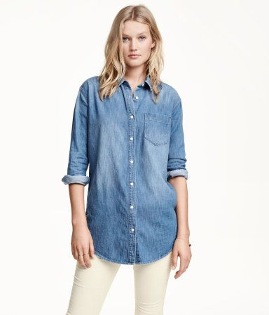 Long, oversized, straight-cut shirt in washed denim with distressed details. Slightly dropped shoulders, long sleeves, chest pocket, and rounded hem.