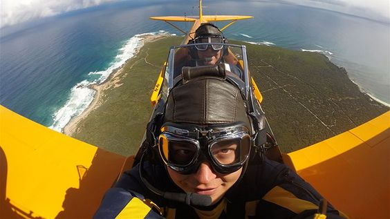 Steve Millington of Busselton, Western Australia loves to fly his twice-resotored Tiger Moth. (Image: courtesy of Steve Millington via ABC)
