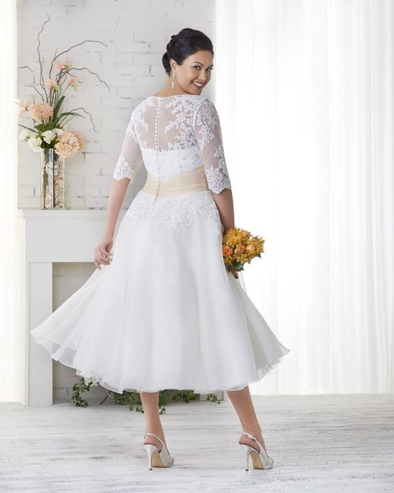 1523 UNFORGETTABLE COLLECTION. Plus Size Bridal Gowns. BONNY BRIDAL. Tea Length. Belt comes in Ivory and White. Lace. Sleeves.