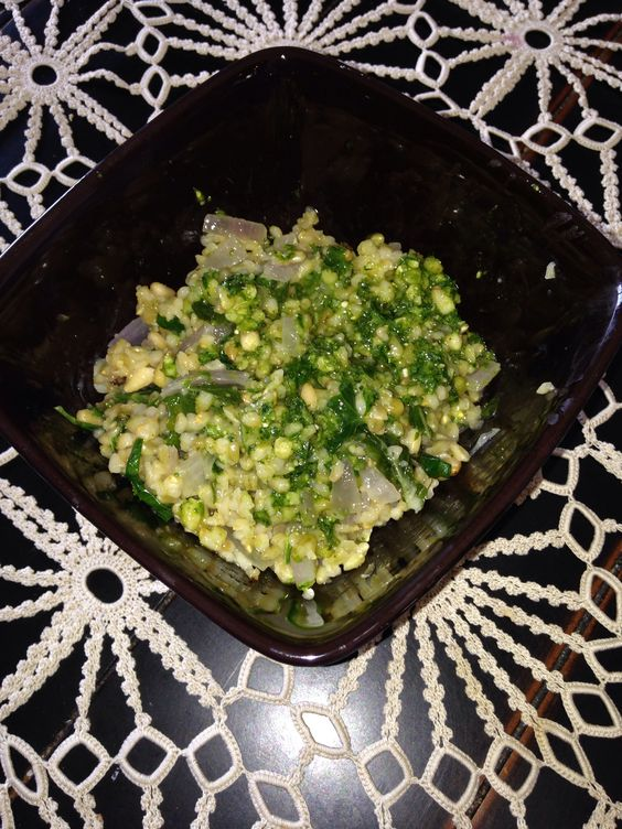 Freekeh is a fire roasted baby green wheat that contains higher protein, vitamins and fiber than traditional wheat!  I LOVE trying new grains...there's a lot!! Here, I added plethara of herbs, onions and pinenuts with left over kale pesto from the fridge!  Now were talkin Freekeh!