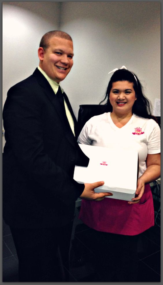 Lime Works president Garrett Gatewood receives delicious gift from Sugar Bake Cupcakes owner Clarissa.