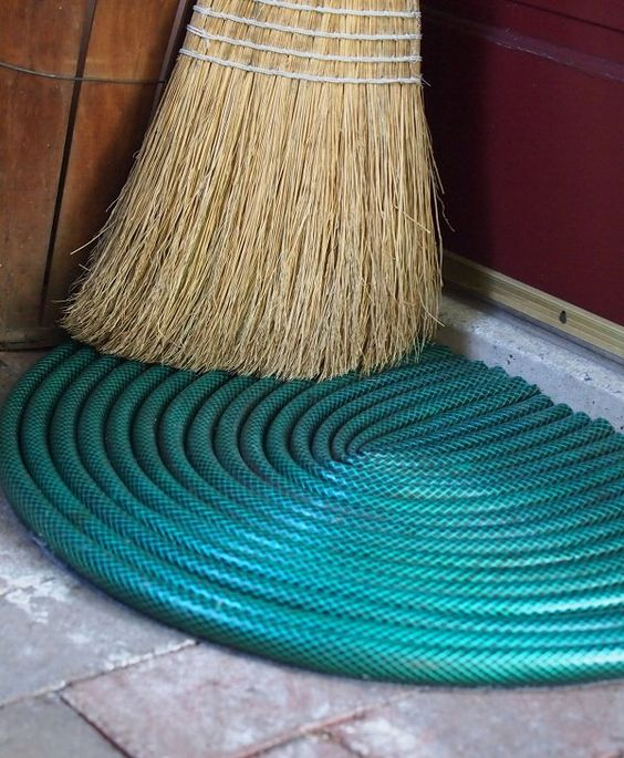 Make your own doormat out of a leaky garden hose.
