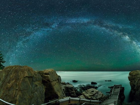Edited photographer note: The Milky Way arcs over Thunder Hole in Acadia National Park.