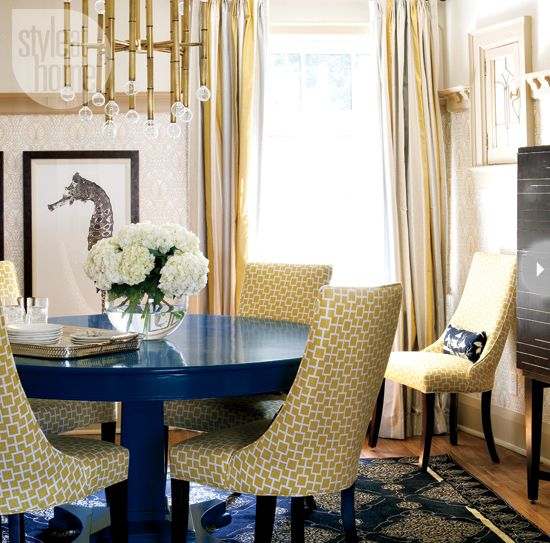 Yellow and navy with touches of gold are an elegant combination for any dining room. {Photography by Virginia Macdonald}
