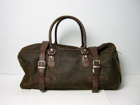 Vintage brown leather buckled duffel bag. $60.00, via Etsy.