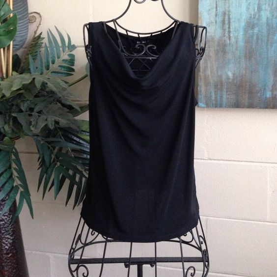 DKNY Top Size Medium DKNY simple black shell top with draping scoop neckline and sleeveless design. Size Medium. Measurements: Shoulder: 13 1/2, Pits: 16 1/2, Top to Bottom: 22 DKNY Tops