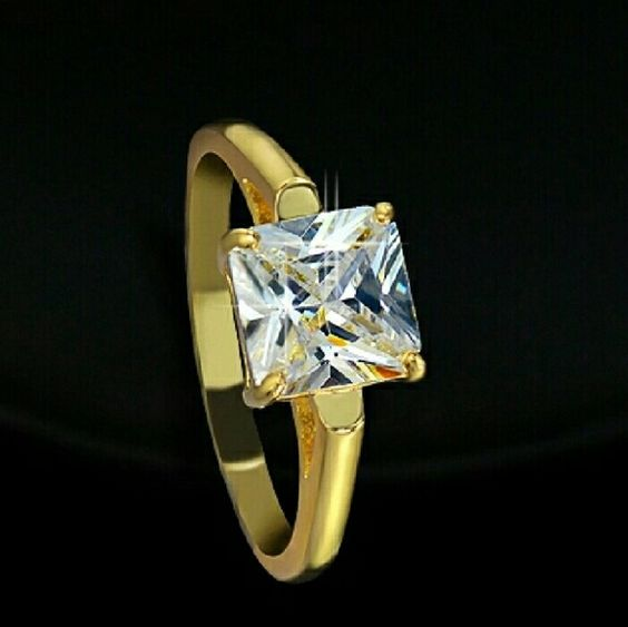 💍Yellow OR white gold PRINCESS CUT 2CTW RING YELLOW OR WHITE GOLD plated White gold sizes only 5, 8 & 9 listed under silver to clarify which color you would  Yellow gold sizes only 5, 6, 7   2 CTW PRINCESS CUT RING WITH PERFECT REVIEWS alloy bonded to sterling silver dipped in 18 kt yellow or white gold  VVSI and EH in color and clarity.  58 facet cut for brilliant light refraction Comes with ring box.  This is very realistic looking princess cut. One of my favorite for light refraction its…