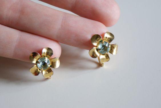 Vintage Light Blue Rhinestone Gold Toned Flower Metal Screw Back Earrings. $10.00, via Etsy.