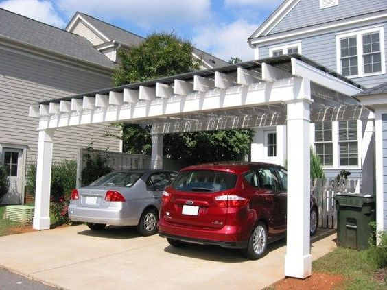 This is the design of car port I want. Perhaps smaller diameter timber posts and then double up on posts on each corner? Maybe have less rafters, probably over kill. Run Rafters inside fascia beam with purlins over top?