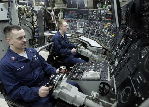 Nuclear Submarine Interior Navy Officers At A Control