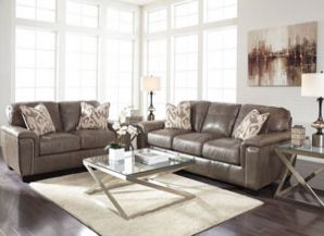 """Thinking about surprising mom with a new living room? We can help! Stop by our show room and take a look at the new Donnell Granite Sofa & Loveseat features top-grain leather in the seating areas with skillfully matched DuraBlend upholstery everywhere else. With beautiful jumbo stitched details adorning the upholstery and brushed pewter nail head accents, the """"Donnell-Granite"""" upholstery collection features a sleek contemporary design while giving you the comfort of plush seating."""