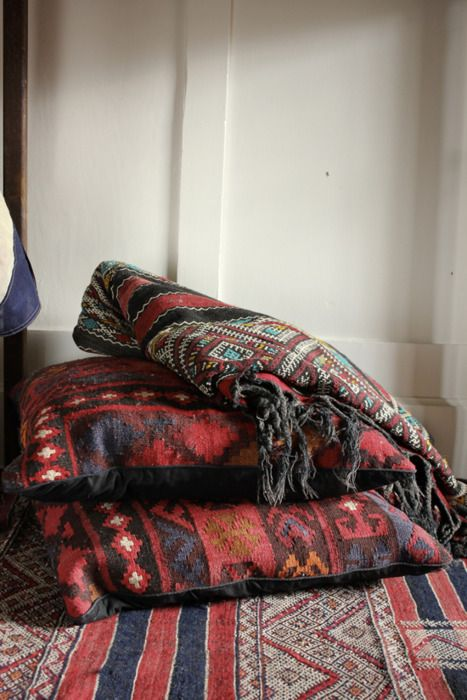 """""""Cut up some of my old rugs to make pillows for indoor courtyard.""""  ...I WOULD LIKE OLD RUGS, PILLOWS AND AN INDOOR COURTYARD."""