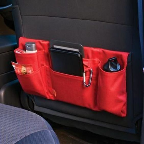 The Travel Tote, a soft-sided pocket that fits conveniently over a seat back, keeps your personal effects nearby on a plane or in a car. No more bending over to grab your essentials! Shop at SkyMall.com!