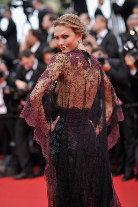 Karlie Kloss attended Wednesday's opening ceremony in a lacy burgundy Valentino dress.