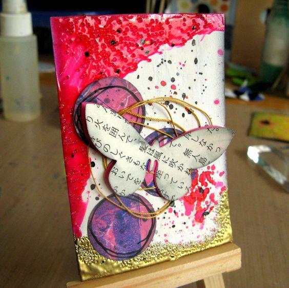 Mixed Media ATC: thread, cardstock, acrylics, book text, pen, dye inks, glass bead gel medium, spray inks, pigment ink, embossing powder