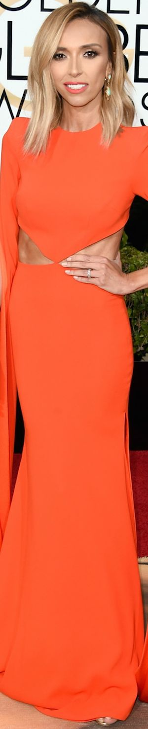 Giuliana Rancic wearing a coral gown by Australian designer Alex Perry. 2016 Golden Globes
