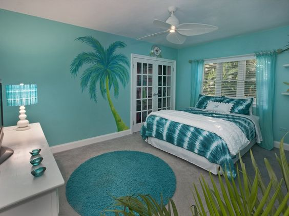 The fan, the blue, the palm tree, the fern ... everything helps with the beach theme. Of course, the glass and the teal colors everywhere really seem to sell it.