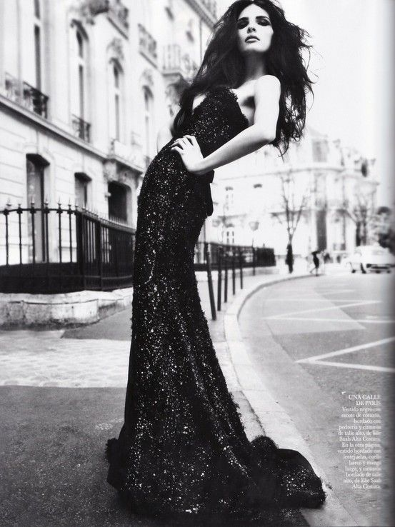 Model posing on street in black gown. I love the way she is posing, the angles of the street, the depth of field and everything about this shot!!