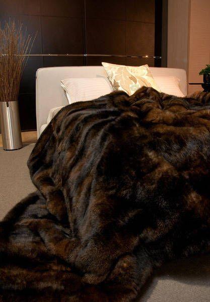 A large California King chocolate brown possum fur bed