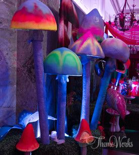 Pool noodles and paper mache tops make psychedelic mushrooms. Great for a Wonderland party!