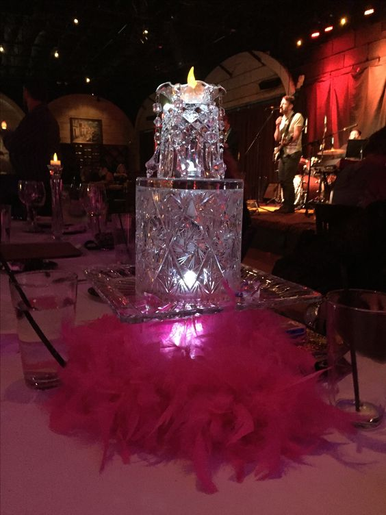 Raymond 50th birthday party centerpieces made out of upside down crystal ice bucket