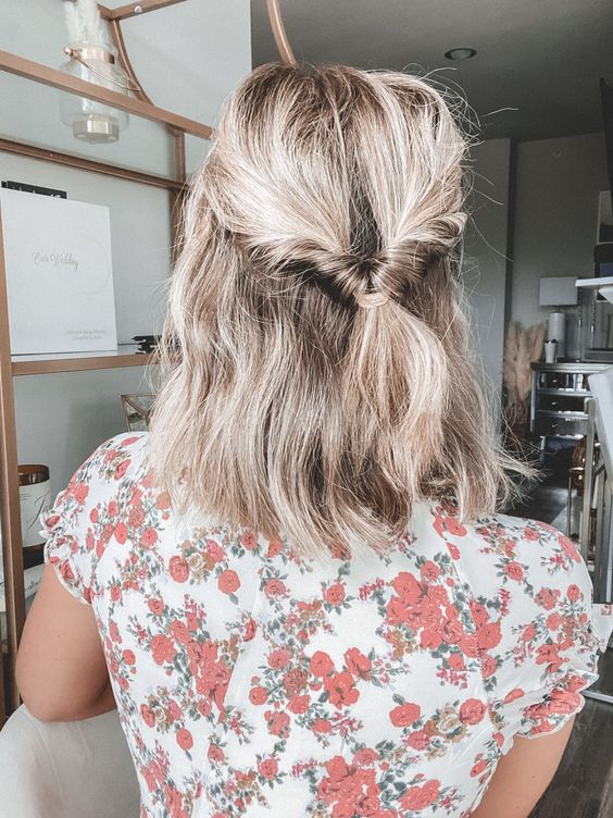 Add a twist to a low ponytail to give shorter hair an elegant touch.