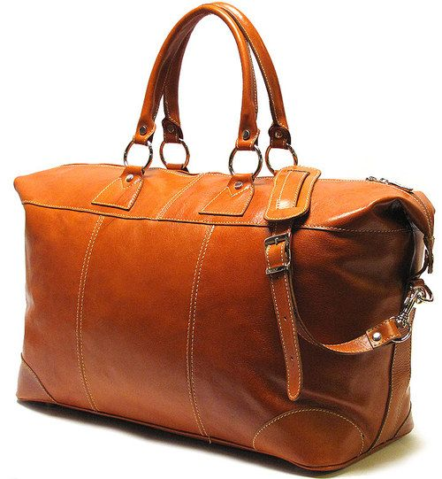 Capri Duffle combines Italian Polished calf-skin leather and smart contrast stitching to create a classic weekend bag. It has a large opening for easy packing and inside zip pocket for holding a passport and travel supplies. Made in Italy.