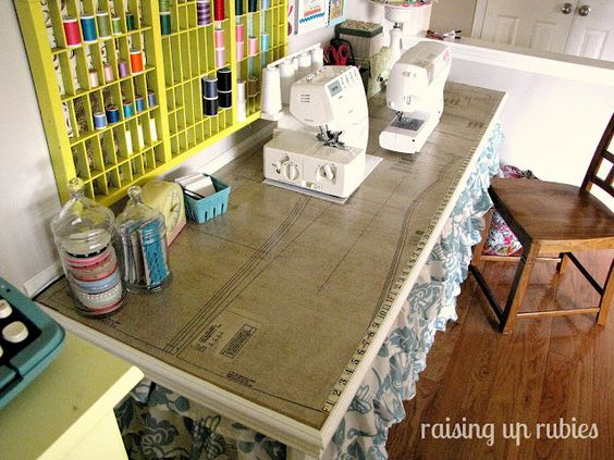 Mod Podged a dress pattern onto the table top for decoration and a tape measure for productivity. - I should do this with the pattern from my wedding gown!