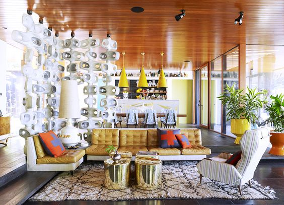 The 11 Greatest Lessons We Learned From Jonathan Adler // living room, room divider, brass gold cocktail tables, Moroccan rug, beach house