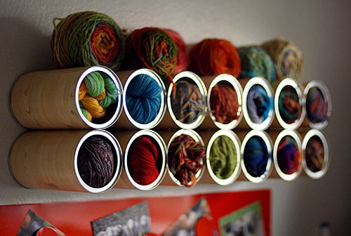 @Livia Johnson  Transform old coffee cans into yarn cubbies.