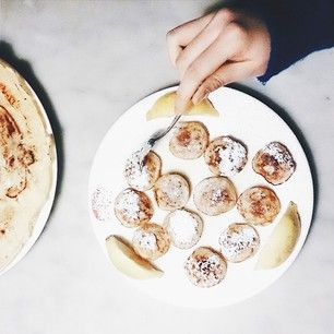Poffertjes from The Pancake Bakery Poffertjes are basically baby pancakes covered in butter and powdered sugar. .