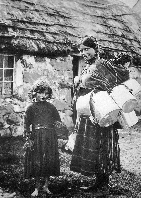 Old photograph of a gypsy with her daughter outside a thatched cottage in Glencoe , Scotland .      All photographs are copyright of Sandy S...