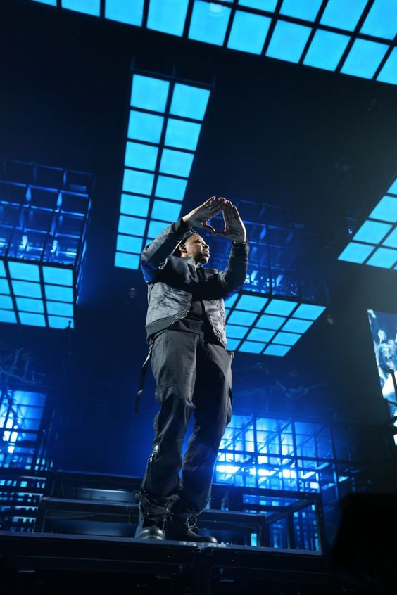 The roc is in the building. Jay-Z throws up the dynasty sign during a performance on Nov. 30 in St. Paul, Minn.