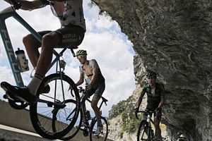 Britain's Adam Yates and France's Angelo Tulik climb during the 19th stage of the Tour de France, which started in Saint-Jean-de-Maurienne and finished at La Toussuire.