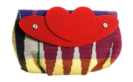 Need a cutie to carry your little must-haves? the Love Saori clutch was awarded Editors Choice by Fabulous Magazine. With its pretty mix of colorful fabric and a heart accent.  www.buymedesign.com  Price $86
